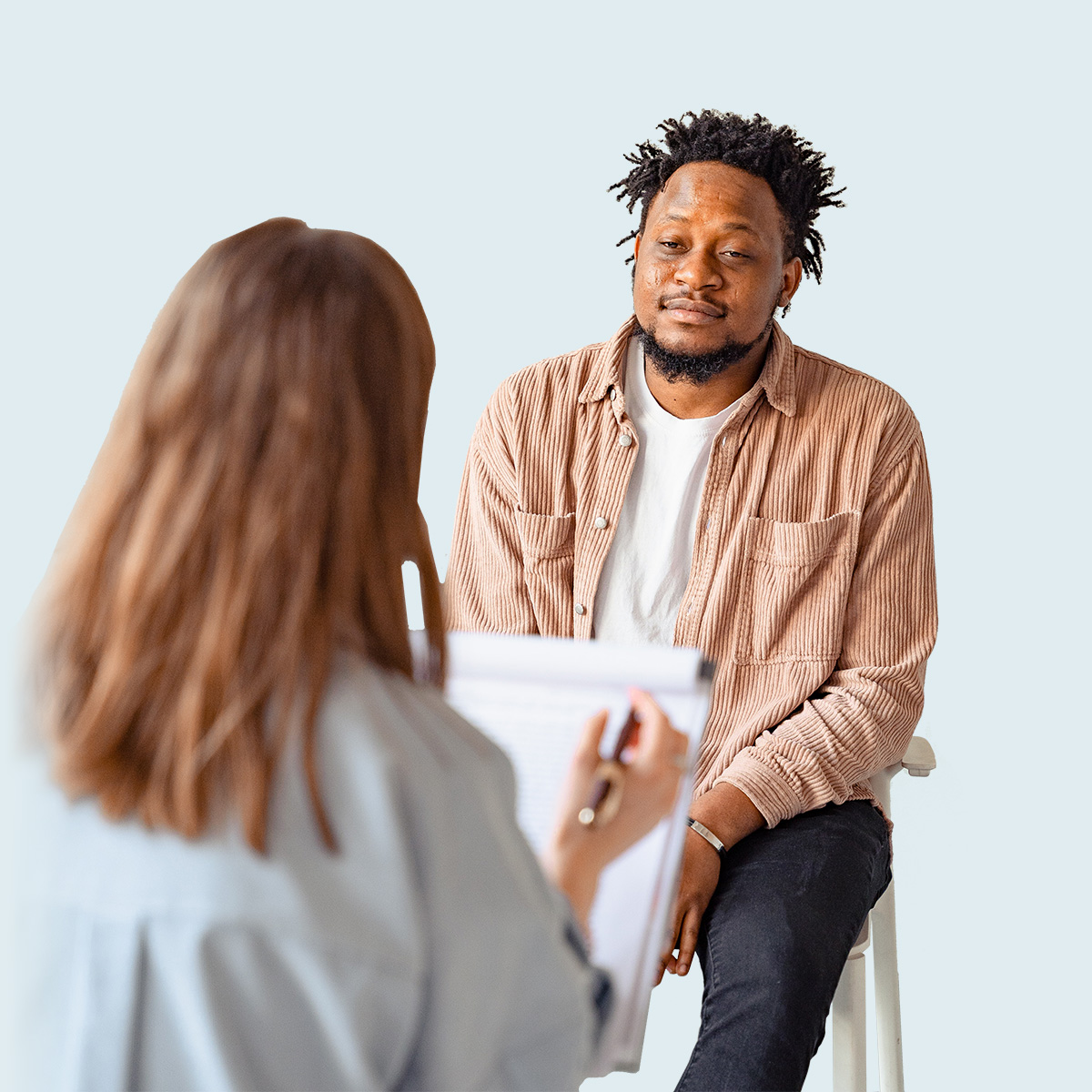 Black man in counseling session with doctor